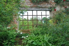 Sissinghurst Castle and Garden - A Window on its Inner Beauty (antonychammond) Tags: sissinghurst sissinghurstcastlegarden flowers shrubs window wall trees vitasackvillewest haroldnicolson nationaltrust kent england contactgroups thegalaxy fugitivemoment natureinfocusgroup