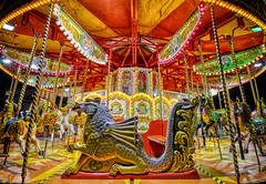 A Midnight Carousel (henriksundholm.com) Tags: city urban night marinabay carousel tivoly ride dragon seat carnival festival lamps lights hdr singapore southeast asia