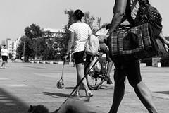 Dogs And Wheels (Alfred Grupstra) Tags: people blackandwhite outdoors men urbanscene women city females street males lifestyles citylife walking youngadult bicycle cycling action adult summer motion dog wheel