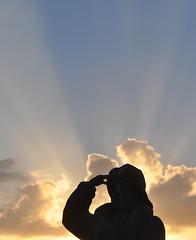 Statue silhouette and sky (Kirkleyjohn) Tags: statue lifeboatman lowestoft light sky rays clouds contrejour backlit