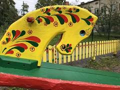 at the playground (Hayashina) Tags: ukraine lviv fence yellow horse playground