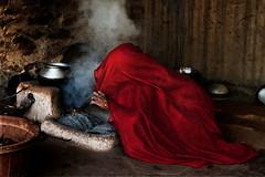 Rabari basti.Chandelao. Rajasthan. India. (Tito Dalmau) Tags: woman meat red rabari basti chandelao rajasthan india