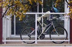 Cold Commuter... (Mister Day) Tags: skeleton bike balcony odd helmet