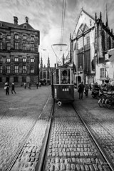 Tram and church @ Dam square (PaulHoo) Tags: nikon d750 ultrawideangle wideangle samyang 14mm blackandwhite monochrome 2018 sun contrast shadow light amsterdam city people candid streetphotography dam square rails tram church palace building architecture