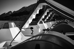 Number 2 (iamunclefester) Tags: vacation holiday croatia krk otokkrk blackandwhite monochrome beach 2 number number2 pedalo paddleboat pedal boat pedalboat stairs seat contrast water sea slide waterslide dof mountains mountain rudder shadows shadow bright sunset handle handrail curvy linedup