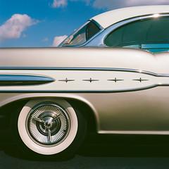 Four star Pontiac (GmanViz) Tags: gmanviz color car automobile vehicle detail nikon d7000 1957 pontiac starchief roof fender wheel tire chrome trim film analog hasselblad 500cm zeissplanar80mmf28 kodakektar100