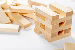 jenga on white background, wooden rectangles for the game (wuestenigel) Tags: wood square education act metaphor skill wooden concept blocks buildings risk development block play build fall brick entertainment jenga child construction create tower games pile object make toy game construct childhood noperson keineperson holz stacks stapel cube würfel indoors drinnen merchandise waren many viele health gesundheit container architecture diearchitektur ingredients zutaten nature natur leisure freizeit interiordesign innenarchitektur cardboard karton nutrition ernährung family familie log carpentry zimmerei box