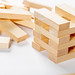 jenga on white background, wooden rectangles for the game
