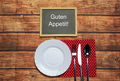 Plate, knife and fork on napkin cloth (wuestenigel) Tags: spoon fork restaurant lunch food table knife plate dinner kitchen wood holz noperson keineperson tabelle retro wooden hölzern empty leeren messer desktop paper papier vintage jahrgang old alt design antique antiquität family familie gabel indoors drinnen steel stehlen decoration dekoration cooking kochen