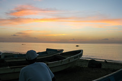 Corn Island (Kelly Renée) Tags: caribbean cornisland nicaraua boats dusk man peaceful sunset regiónautónomadelatlántico nicaragua regiónautónomadelatlánticosur ni
