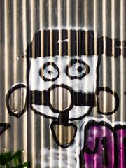 Bondage (Steve Taylor (Photography)) Tags: bondage graffiti streetart black purple white newzealand nz southisland canterbury christchurch newbrighton corrugated eyes hole