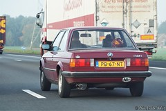 1986 BMW 316 (NielsdeWit) Tags: nielsdewit car vehicle auto pb67nt bmw e30 316 3series driving a12 highway red