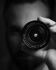 Holding a lens. (pedferr) Tags: glass portrait face cinematic closeup people vertical moody southamerica 4x5 film indoor selfie male selfportrait photographer monochrome man beards lifestyle object artistic brazil blackandwhite eyes detail