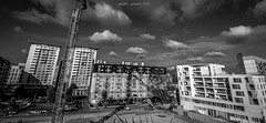 Town Planning (Frédéric Fossard) Tags: monochrome noiretblanc blackandwhite chantier grue ville travaux bâtiment ciel sky nuages clouds city grandangle constructionsite constructioncrane town immeuble habitation building publicworks travauxpublics rue street place construcion dwelling architecture urbanization urbanisation france îledefrance urbanisme townplanning construction urbain urban tour tower