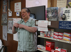 Carpenter stands in the doorway of the pharmacy.