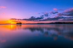 sunset 7244 (junjiaoyama) Tags: japan sunset sky light cloud weather landscape purple orange yellow blue contrast color bright lake island water nature autumn fall calm dusk serene reflection