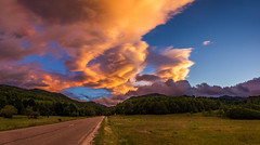 Clouds moments (Pan.Ioan) Tags: landscape sky horizon mountains nature outdoors road field green grass trees sunset orange blue beauty beautiful clouds