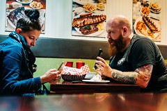"""""""Can you explain this to me ?"""" (SebRiv) Tags: boulevardstlaurent maindelisteakhouse candid moment summicron35mmf2 tattoos ruestlaurentmontreal québec restaurant themain 35mm mad m10 leica killer couple streetphoto canada montreal diner situation tatoos"""