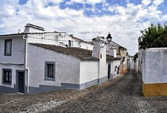 Street in Evora (Jocelyn777) Tags: houses villages towns historictowns whitevillages streets stone cobblestones clouds alentejo evora portugal travel