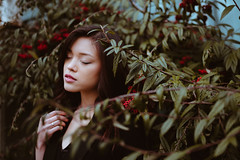 Nature within the Concrete (MarvinHrrr) Tags: girl asian woman brunette beautiful pretty eyes closed emotion hands red berrys bokeh pentax sigma canada vancouver moody