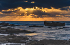 Sun Rays though the Clouds over the Sea (Merrillie) Tags: daybreak theskillion nature australia terrigal rocky morning sea waterscape newsouthwales rocks earlymorning nsw coast landscape ocean dawn cloudy sunrise coastal clouds outdoors seascape waves centralcoast water sky
