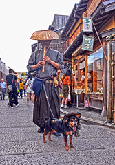 Buddhist with Flute and Dog (tacosnachosburritos) Tags: kyoto ancient kiyomizudera tourists thestreets street photography man guy girl woman lady chick kimono turning japanese japan shops shopping road pretty beautiful lovely people asian humanity landscape temple lantern buddha faith dog flute buddhist
