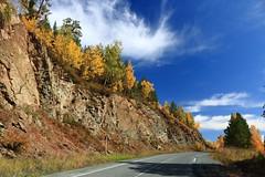 Road Abaza - Ak-Dovurak in autumn, Khakassia, Russia (Fedor Odegov) Tags: khakassia russia siberia autumn road trees cliff sayan mountains