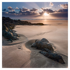 Newborough Square (Ollie Pocock) Tags: north wales anglesey beach seascape beachscape landscape landscapes uk sunset sunstar sand rocks sea seascapes