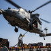 An MH-60S Sea Hawk helicopter prepares to transport cargo.