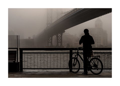 Early Morning At The East River (Nico Geerlings) Tags: ngimages nicogeerlings nicogeerlingsphotography nyc ny usa newyorkcity manhattan eastriver chinatown manhattanbridge dumbo brooklyn fog foggy mist streetphotography biker silhouette architecture fujifilmxt2 xf56mm urban gritty