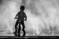 Disappearing Boy (sdupimages) Tags: parisian parisien paris monochrome blackwhite noirblanc noiretblanc bw nb street rue mist brume eau water shadow ombre silhouette boy kid enfant garçon velo bike