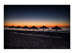 Lazy Day Ahead (Deek Wilson) Tags: beach sunrise costadelsol torremolinos seascape mediterraneansea sky bluehour umbrella shade silhouette sun lounger