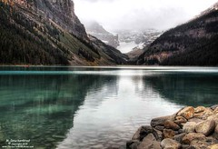 Reflection of the Mountains in the Turquoise Waters of Lake Louise (PhotosToArtByMike) Tags: lakelouise emeraldlake turquoisecoloredwater reflection mountainreflection banff banffnationalpark turquoisewaters canadianrockies albertacanada mountain mountains boathouse canoerentals