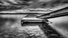 Moody in Mono (Jens Haggren) Tags: jetty bridge sea seascape water reflections sky clouds rocks mono bw le longexposure olympus em1 nacka sweden jenshaggren