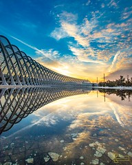 Nations' Wall (Kostas Trovas) Tags: athens greece hdr olympicsportscomplex reflection santiagocalatrava sunrise arches architecture clouds colors composition landscape morninglight sky symmetry tunnel urban