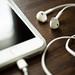White phone earphones on wood