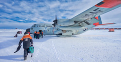 Leaving Antarctica (Trey Ratcliff) Tags: antarctica ratcliff stuckincustomscom trey treyratcliff treyratcliffcom ice plane wings snow white clouds blue army air force fly flight extreme cold scott base