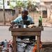 Kumasi afternoon - shoeshine man portrait