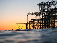 Brighton's West Pier (lomokev) Tags: england unitedkingdom gb file:name=181009omdem5090069 westpier pier olympusomdem5 olympus omd em5 olympusomd brighton wideswimming dusk sunset dof depthoffield focus