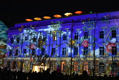 Festival of Lights 2018 Berlin (Lady Black) Tags: building illuminated blue red roses 6 six orange umbrellas yellow buds green leaves growing hedge windows