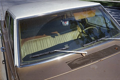 Mary on the mirror (ADMurr) Tags: dab020 la dodge 1970s brown virgin guadalupe mirror stem torn seat 70s colors leica m6 kodak 50mm bright