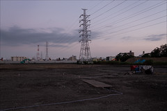 odai-6137-ps-w (pw-pix) Tags: dirt gravel flat level buildingsite constructionsite hose cable covering steel plate trench ditch tanks boxes storage equipment materials excavator pegs markers fence buildings trees mounds piles embankment wires pylons electricity transmission highvoltage lights night evening dark pylon poles cables grass betweensumidaandarakawarivers 449route odai adachiku tokyo tokyoto japan peterwilliams pwpix wwwpwpixstudio pwpixstudio