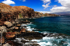 Wall of rock (Peter Szasz) Tags: maui hawaii summer sky sea stones scenery beach rocks clouds blue tropical pacific water deep day ocean landscape bright brown hillside hill clear outside foam barren dry hot nowhere macgregor