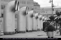 ARTSY PIECES NEAR TRAIN STATION (PARIS) (lindenhud1) Tags: garedelyon trainstation paris france pipes modernart visual outside french parisfrance interesting europe street largepipes portpipes bw blackandwhite monochrome buildings weird different