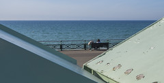 Relaxing On Hove Seafront (grahambrown1965) Tags: beachhut beachhuts ricohimagingcompanyltdpentaxk3ii ricoh pentax k3ii pentaxk3ii sigma 1020mm sigma1020mm brighton water sea beach shingle hove brightonandhove motherandpram pram