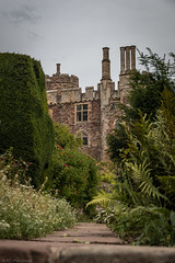 Through the gardens (Anthony P.26) Tags: architecture berkeley berkeleycastle category england external flora gloucestershire places travel canon1585mm canon canon70d outdoor architecturephotography garden plants trees walls stonebuilding castle uk greatbritain english tree grass