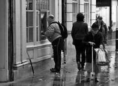 Checking Her Change! (WorcesterBarry) Tags: blackwhite bnw blackandwhite places people photographers paths outdoors old monochrome mono england lovebw reflection rain street streetphotography streetphoto streetartist eating candid city