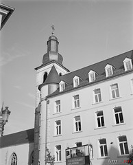 Old Hospital with Church (fs999) Tags: fs999 fschneider aficionados zinzins plaubel makina 67 plaubelmakina67 6x7 film camera filmcamera 60x70 ashotadayorso topqualityimage topqualityimageonly artcafe pentaxart corel paintshoppro paintshoppro2018ultimate 2018ultimate nikkor12880mm nikon nikkor 128 80mm 8028 luxembourg luxemburg lëtzebuerg kodak trix 400 trix400 400tx 400iso blackwhite blackandwhite bw noirblanc noiretblanc nb blackwhitephotos caffenol clcs cold start stand home development plustek opticfilm 120 scanner 2400dpi silverfast ai studio filmdev:recipe=12064