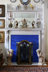 Rallo has added his own touch on the home with porcelain trinkets and gargoyle statues. This room was the living room of the Hidden family, but Rallo has transformed it into an authentic parlor.