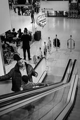 Welcome Home; Heathrow Airport (Edmond Terakopian) Tags: portrait airport dailylife candid heathrow balloon myexposureedit exposurex4 lumix lx100m2 compactcamera